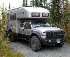 EarthRoamer.   Can take a trip from Tierra del Fuego, Argentina to Gnome, Alaska on 12 tanks of biodiesel. A great way to go on an adventure and have super low impact. Biodiesel and Solar powered!