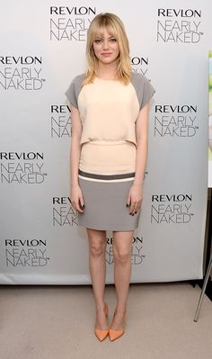Emma Stone Style: Emma sported this polished nude-and-gray Daniel Vosovic raglan-sleeved dress with peachy Rupert Sanderson pointy-toe pumps for a Revlon event in December 2012.