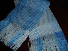 "Do you love the beauty of the blue skies and the deep blues of the ocean?  This lovely handwoven scarf has the undulating colors of the ocean waves and the colors of a lovely summer sky.  This ladies scarf is woven from the softest tencel yarn and has a lovely drape and feel.  Get it today and ""be one with the waves and clouds! https://www.etsy.com/shop/JoyfulNoiseWeaving"