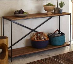 """Railroad Tie Console Table    The wood for this console table originates from authentic hardwood railroad ties. The wood is then sandblasted, revealing the original warm tone, and preserved with a wax finish. Simple assembly required. Made in India. 60""""W x 15""""D x 34""""H"""