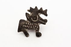 Black Clay Deer Stamp - This stamp is a one of a kind (as are the other clay stamps in our store).  From the southwest coast of Ecuador between Salinas and Montanitas, this stamp is old, but not antique.  Most likely based on designs from the Valdivia culture, the stamp represents a deer and can be applied to clay while wet to create an impression.  It can be used or just enjoyed.