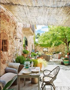 Casanovas Farmhouse - in a nature reserve of mountainous Sant Llorenç del Munt, just outside of Barcelona, this restored farmhouse is just oozing with rustic charm and bohemian allure.