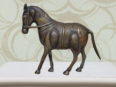 Bronze Horse statue serves as a great statement piece for your home Exclusively  designed only at https://www.indianshelf.com/category/bronze-statement-pieces/