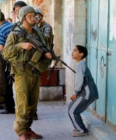 the coward Israelian soldier and Palestinian boy