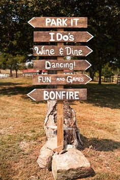 diy rustic signs for reception. I'm so having a bonfire!