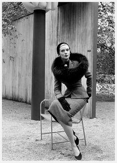 1950    Barbara Wood models a tailored tweed town suit with black fox circle by Omar Kiam, pearl brooch by Trifari.