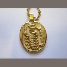 A zodiac pendant, by Cartier, 1970s, portraying a scorpion, the zodiacal sign of Scorpio. (Bonhams)