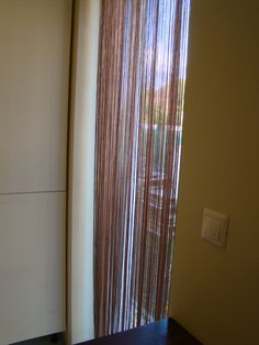 Spaghetti string curtain for kitchen window