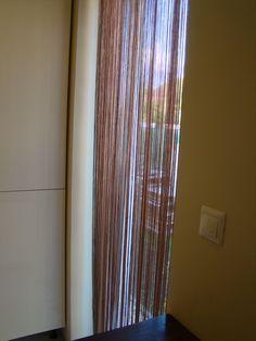 Spaghetti string curtain for kitchen window