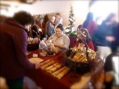 "The Blue Box Pantry ladies sell dried soup and chowder mixes at ""The Little Christmas Fair""."