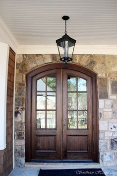 double front door with lantern light fixture. I want these doors on my next house! Door and stone colors Casas En Atlanta, Arched Front Door, Double Front Entry Doors, Front French Doors, Stained Front Door, Door Entry, Door Design, House Design, Exterior Design