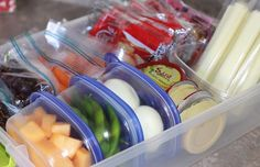 12 DIY Kitchen Projects to Clean Up Your Eating Habits -- love the smart snack bin (in pic), the days-of-the-week bins, a few other ideas on this