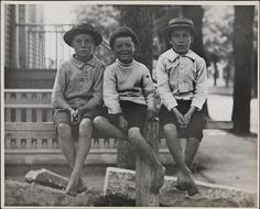 The faces of Hell's Kitchen 1900: Group portrait of three boys sitting on a wooden fence. Photographed by Robert L. Bracklow, a long-time resident of the ragged neighborhood. Not sure of this exact location, but I might hazard to say it's the old mansion that once sat on the spot of today's DeWitt Clinton Park. (Courtesy Museum of the City of New York)/