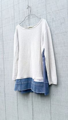 This one-of-a-kind upcycled winter white tunic is perfect for work or playing in the city! Made from a up-cycled cotton sweater, jersey knit and denim and pieced it together in a funky kind of way that is very flattering to the body. Pair with leggings an