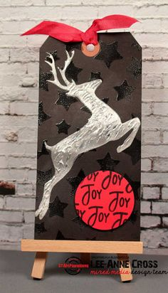 Mixed media Christmas tag using ARTplorations stencils and STAMPlorations stamps