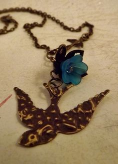 'Bird in Flight Necklace' is going up for auction at  6pm Thu, Mar 7 with a starting bid of $7.