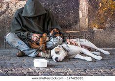 beggar, homeless with two Dogs near Charles Bridge, Prague - stock photo