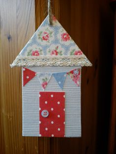 Handmade beach hut made with fabric stuck on an MDF shape cut out by hand