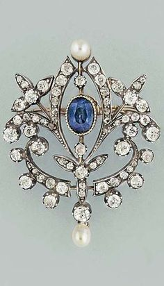 A late 19th century sapphire, pearl and diamond brooch / pendant. The openwork plaque, the central collet-set oval mixed-cut sapphire within a knife-wire scrolling foliate surround set with old brilliant-cut diamonds, and two pearl highlights, circa 1880, 4.5cm long, please note that the pearls have not been tested for natural origin, fitted case