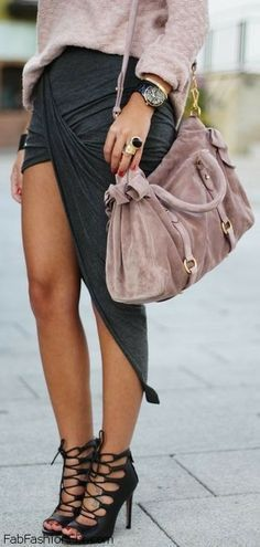 Chic spring look with soft colors and assymetrical skirt