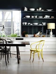 Dark open shelving in the Melbourne kitchen of stylist Fiona Richardson. Photo by Derek Swalwell.