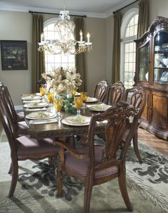 The Ledelle Dining Table From Ashley Furniture HomeStore AFHS With Rich Old World Beauty Of Serpentine Flowing Curves And Elaborately Mo