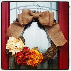 My new fall wreath! Grape vine wreath, some burlap, hydrangea stems and a dreary afternoon and voila! :)