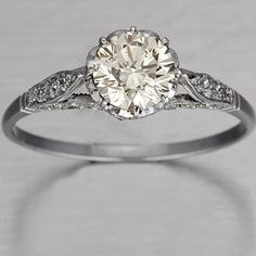 Not normally a fan of round stones, but this is beautiful! Love the vintage look