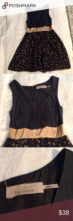 Anthropologie (Burlapp) Black Silk Cocktail Dress A gold polka skirt, gold silk waist band and rose embellishment on the chest give this little black dress a lot of personality.  The embellishment makes this dress unique without being over the top and the polka dots make it whimsical.  Bought from Anthropologie and worn a few times but still looks new.  Fits sizes 0-2/XS-S.  Offers welcome! Anthropologie Dresses