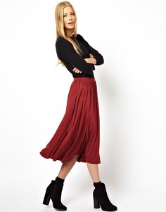 Black jumper, russet coloured midi skirt, and black block heeled boots.