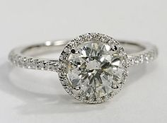 An elegant creation, this diamond engagement ring in 14k white gold showcases a thin line of micropavé-set diamonds that encircle your center diamond. Setting includes 1/4 carat total diamond weight. (in love)