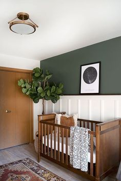 Love the wood trim, doors, white wainscoting and forest green walls #green #wood