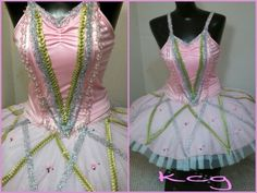 Alterations. Nutcracker season! Pretty GumDrop costume. The top is from one costume, the skirt from another and the tutu from a third. Added silver and green trim and tiny rose accents.