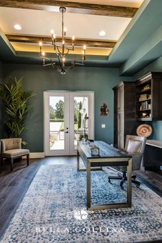 Modern office with Monte Carlo style rug. Wood beam ceiling with tropical and dark wood accents. Downtown Orlando, Custom Builders, Luxury Office, Build Your Dream Home, Real Estate Companies, Central Florida, Estate Homes, Custom Homes, Home Office