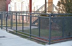 A custom modern perforated metal fencing system fabrication and installation in Chicago.