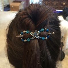 Tidepool Treasure flexi hair clip in bright blue green colors inspired by tropical seas. Perfect for wearing at the beach!