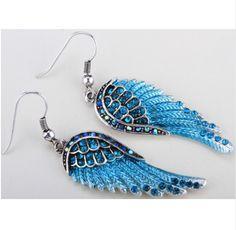 Item specifics Earring Type:Drop Earrings Item Type:Earrings Fine or Fashion:Fashion Gender:Women Style:Rock Material:Crystal Metals Type:Zinc Alloy Shape\pattern:Feather Wing length:4cm (1.5inch) Pro