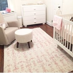 One of our new recycled sari silk flatweaves at home in this new baby girls sweet nursery! . Pattern is Biami.  #eskayel #flatweaves #rugs #eskayelrugs