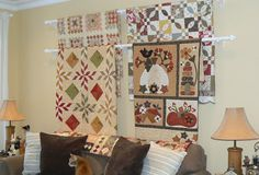 Hard to choose? What an easy way to display multiple quilts, regardless of size!