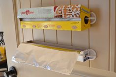 Get alumimum foil and plastic wrap out of a drawer and up where you can reach them. Strategically placed hooks help boxes hang vertically on the back of your pantry door. See more at Ask Anna »  - GoodHousekeeping.com