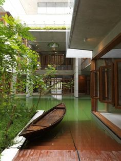 I would love this, a pool/pond right up to the back deck and you have to use a little boat to get around. So novel.