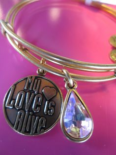 Tuesday's Children (My Love is Alive bangle) & Living Water International (Living Water for Women bangle) #CharmedByCharity
