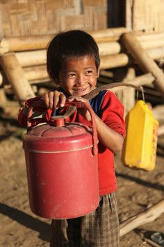 Boy from rural community on his way to collect water in Pha Oudom, Laos by Plan Asia, via Flickr