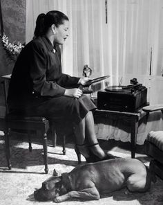 Bille Holiday, her pitbull Mister and her turntable, 1945