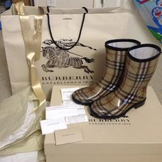 Burberry large size auth gift bag,ribbons and pap Authentic large size gift bag and ribbons and paper wrap from BURBERRY just bought pair of rain boots at burberry store has receipt and product card just demonstrate for proof of authentic. Selling gift bag and ribbons and paper wrap. Three items in good deals 💯👍🎁. Burberry Accessories