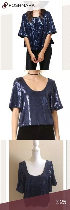 """$98 NEW Free People 'Night Fever' Sequin Top $98 NEW Free People 'Night Fever' Sequin Top in Navy ~Size S~  New without tags. Retails for $98+ Tax  Great for a night out!  Navy sequin throughout entire top Wide, short sleeves Lined  Size S  Measures approximately: total length 20"""" bust across 18"""" 100% polyester  High end department store shelf pull- new without tags. May have had customer contact  PRICED TO SELL FAST! PLEASE ASK ANY QUESTIONS BEFORE PURCHASE, THANKS CHECK OUT MY OTHER…"""