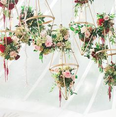 Gorgeous Wedding Details You Can Definitely DIY | Hanging florals are a romantic addition to any spring wedding and a simple DIY. All you'll need is wood for the frames, fishing wire to hang them, and beautiful blooms to top it all off. Add string, yarn, or floral garland for an extra dose of drama.