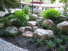 landscaping with boulders designs can easily include making stone steps from fieldstone boulders