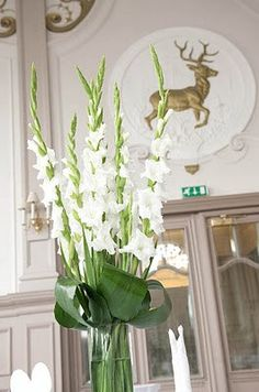 White gladioli wedding centrepiece - can't go wrong with white white and white