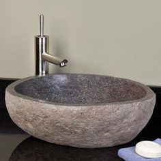 This stone bathroom sinks is the smaller of three options. It is hand crafted from Balinese Granite river boulders and makes a strong statement in any bathrooms. They are earthy and bold and granite s